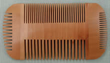 Double sided pear wood beard comb